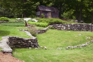 The stone wall behind stonehurst, headquarters for Vermont Woods Studios