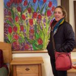 Brattleboro artist Janet Picard with her painting