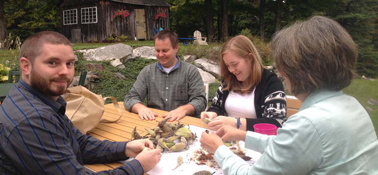 Sean, Douglas, Loryn and Michelle are preparing milkweed seeds to be donated to the seedbank at Monarch Watch.