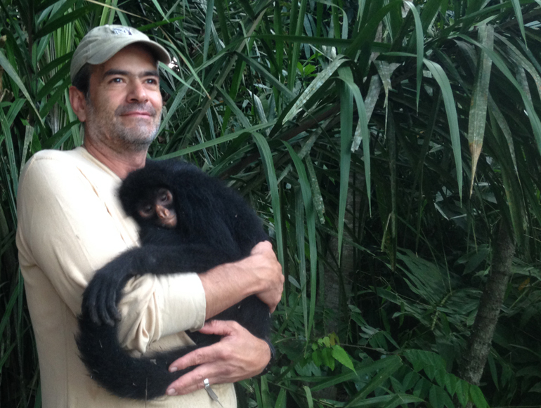 Diego caring for an orphaned spider monkey | Conservation through ecotourism