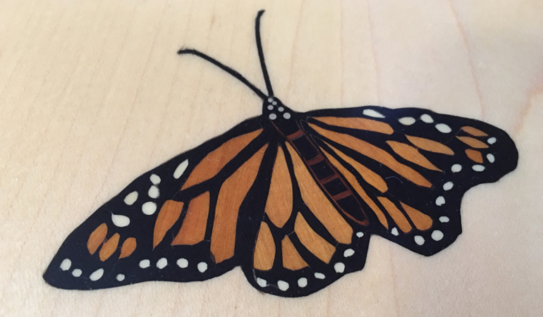 Inlaid monarch butterfly on maple end table