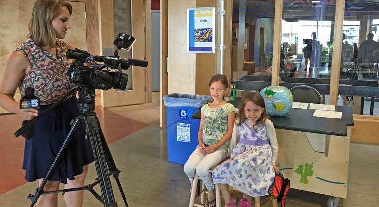 Young monarch fans working the WCAX cameras at the ECHO Center in Burlington, VT.