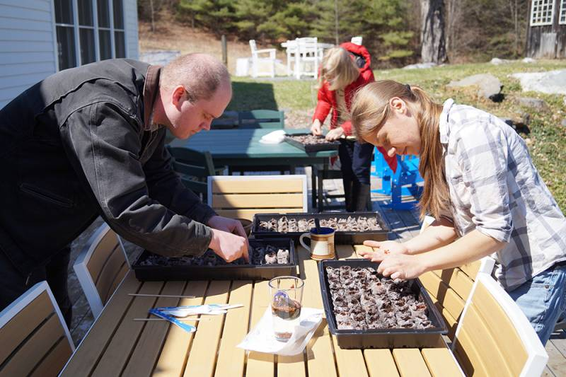 Mike and Nina are on the deck at Stonehurst, planting milkweed for monarchs.