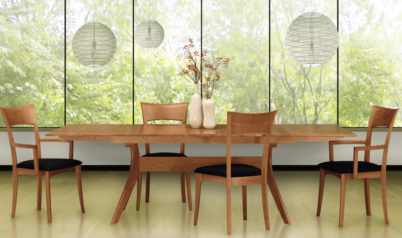 Copeland's Audrey cherry extension table looks beautiful against a background of bright greenery