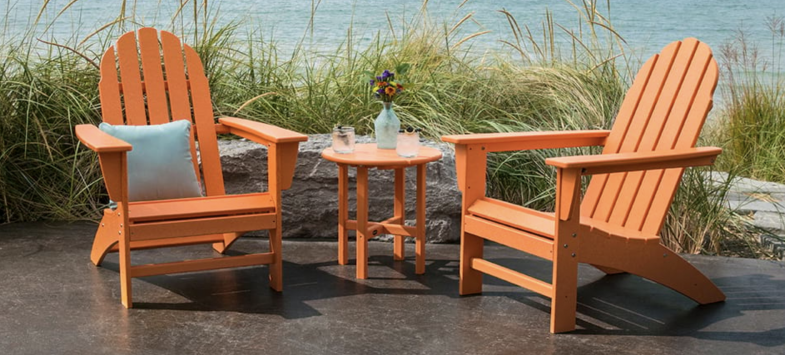 Adirondack chairs in orange & other bright, bold colors. POLYWOOD recycled plastic outdoor furniture.