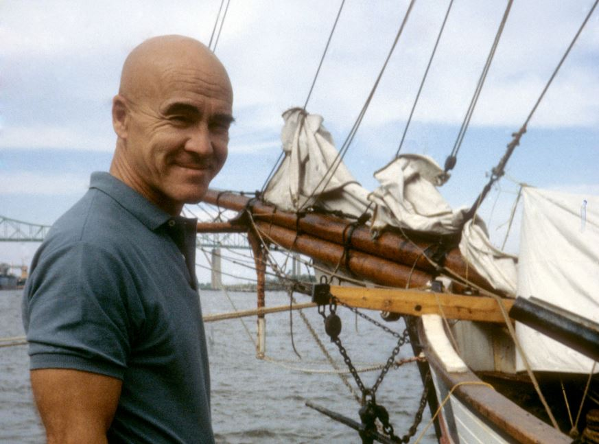 Adrian Pearsall stands in front of one of his sailboats