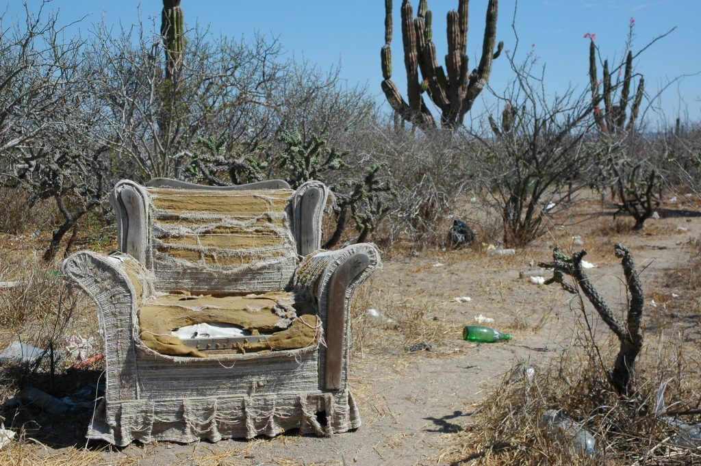 An old chair left in the desert to rot