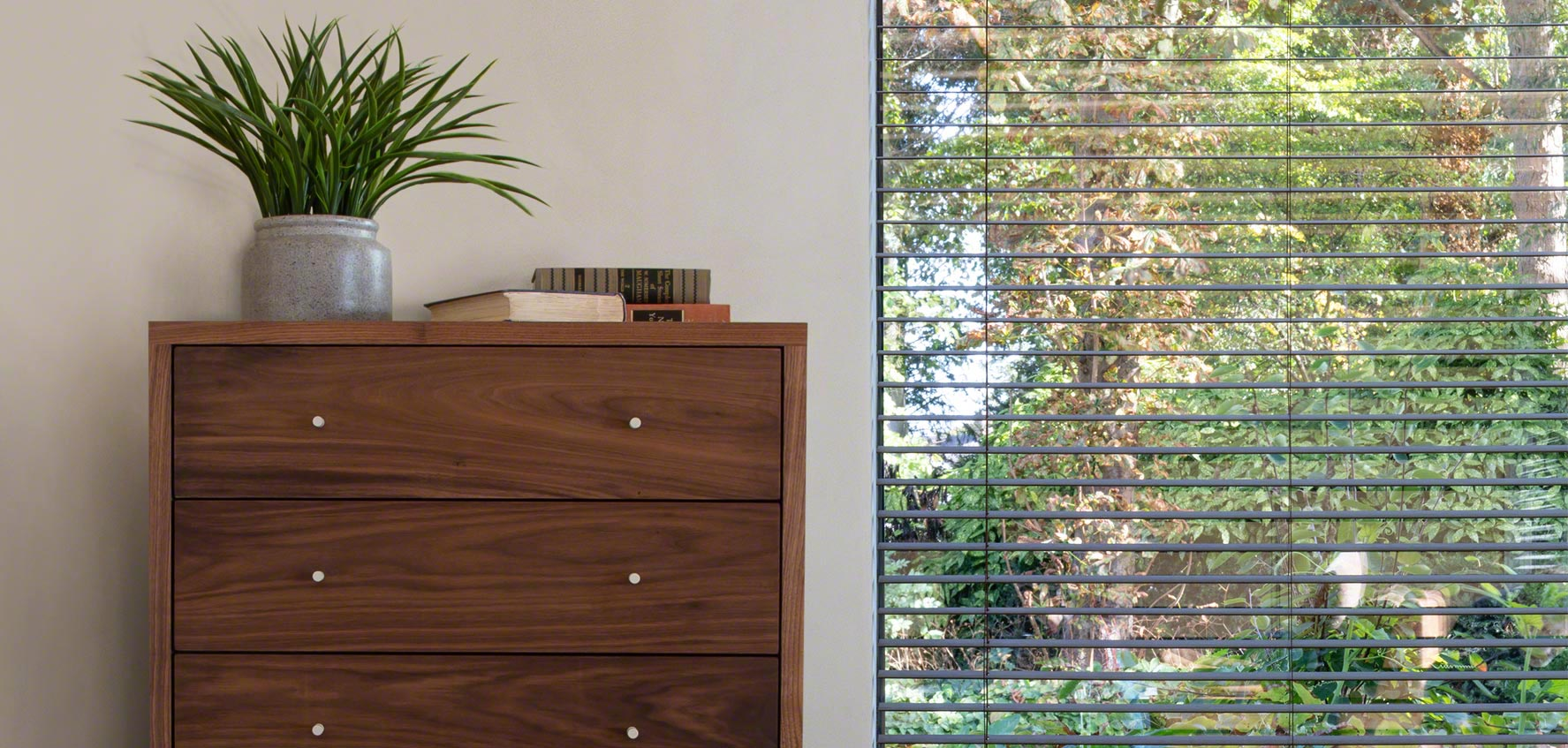 Larssen Chest in solid walnut with plants and window
