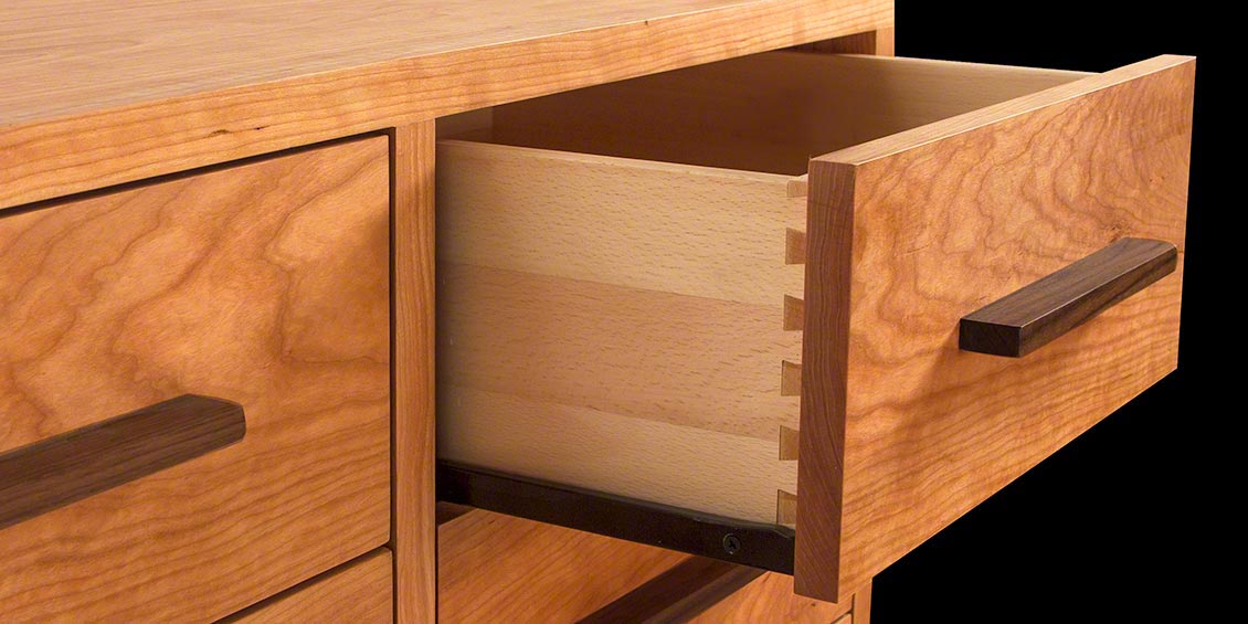 Dovetail joinery technique shown on cherry dresser drawer front